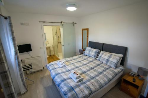 A bed or beds in a room at Corran Bunkhouse