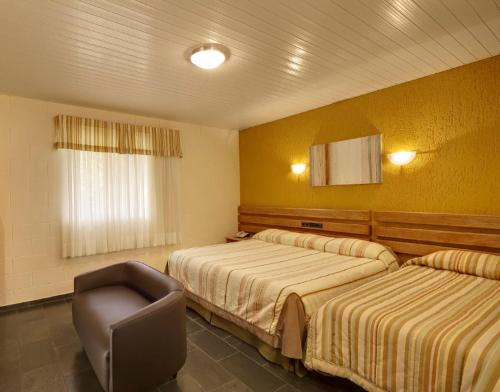 A bed or beds in a room at Capivari Ecoresort