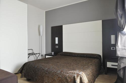 A bed or beds in a room at Casa Boffa