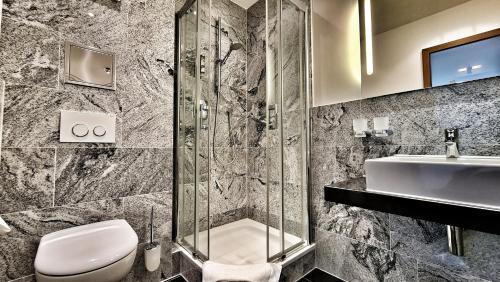 Ein Badezimmer in der Unterkunft Hotel Restaurant Felix