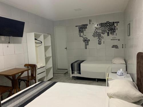A bed or beds in a room at Pousada Praia Boa Viagem