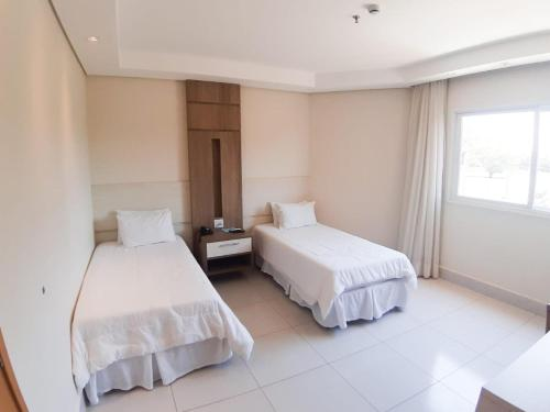 A bed or beds in a room at Hd Park Hotel