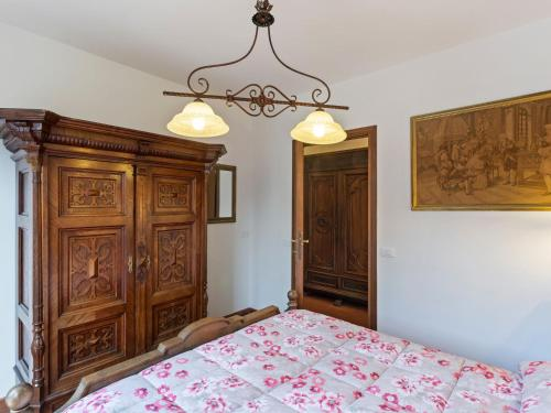 A bed or beds in a room at Splendid Villa in Olgiata with Private Swimming Pool