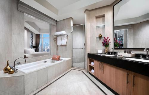 A bathroom at The Residences of The Ritz-Carlton Jakarta Pacific Place