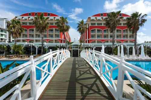 The swimming pool at or near Orange County Resort Hotel Belek - Ultra All Inclusive