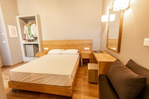 A bed or beds in a room at Esperance 2