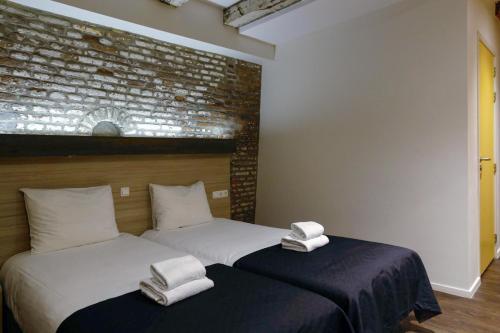 Un ou plusieurs lits dans un hébergement de l'établissement City Hotel Amsterdam