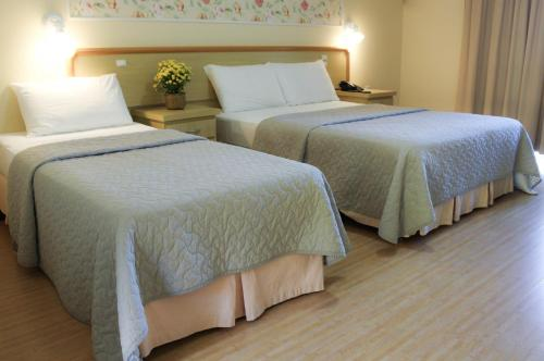 A bed or beds in a room at Hotel do Santuário