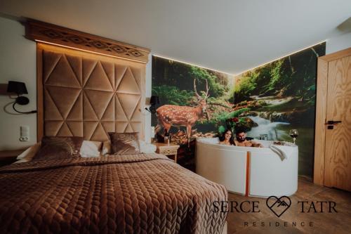 A bed or beds in a room at Serce Tatr Residence Zakopane - blisko Krupówek