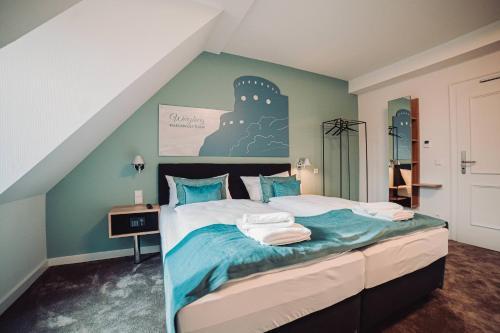Ein Bett oder Betten in einem Zimmer der Unterkunft Zur Stadt Mainz