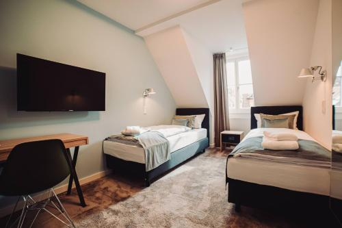 A bed or beds in a room at Zur Stadt Mainz