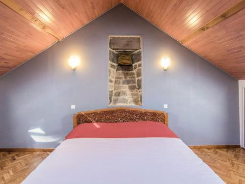 A bed or beds in a room at Modern Villa in Serilhac with Private Pool
