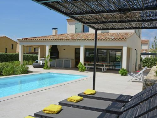 The swimming pool at or near Villa Les Collines