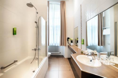 A bathroom at Welcome Hotel Residenzschloss Bamberg