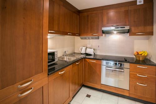 A kitchen or kitchenette at Grand Canal Square Apartments