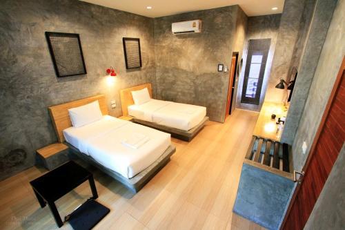 เตียงในห้องที่ THAI THANI Loft & Life Lamphun