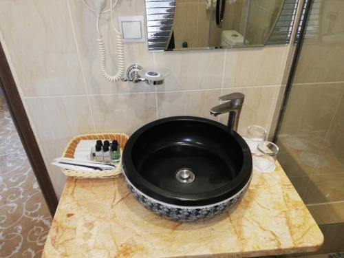 Ванная комната в Greenwich Hotel