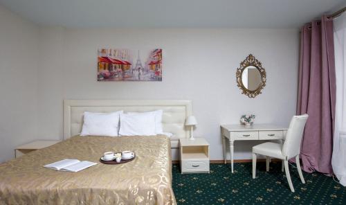 Кровать или кровати в номере Три Мушкетера