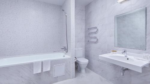 Ванная комната в Кантри Резорт Отель