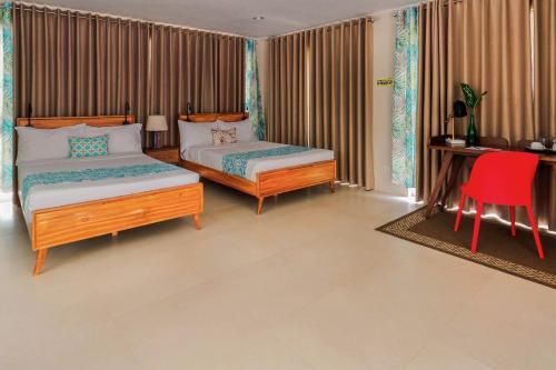 ホテル キンバリー タガイタイにあるベッド