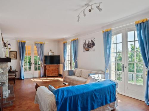 A seating area at Attractive Villa in Velines with Private Garden