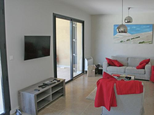 A television and/or entertainment center at Modern Villa in Malaucene with Swimming Pool