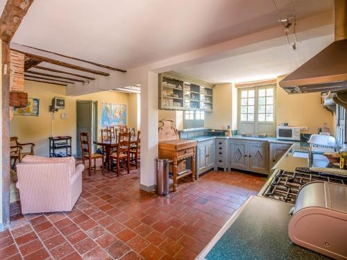 A kitchen or kitchenette at Beautiful Farmhouse With Private Pool in Toujouse France