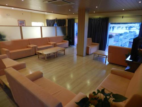 A área de bar ou lounge em Hotel Nossa Senhora da Saude