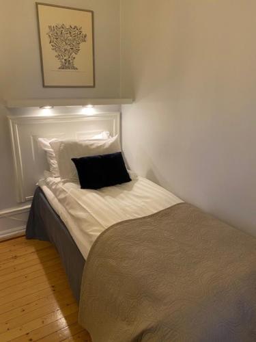 Ein Bett oder Betten in einem Zimmer der Unterkunft Slottshotellet