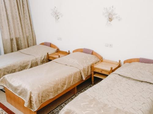 A bed or beds in a room at Smart Hotel KDO Novosibirsk