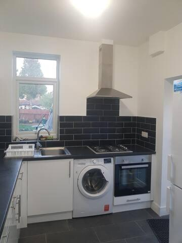 A kitchen or kitchenette at Cosy En_suite Double Room in Edware