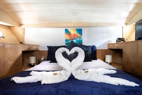 A bed or beds in a room at Riverscapes Classic French Motor Yacht