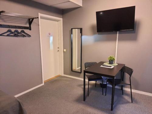 TV tai viihdekeskus majoituspaikassa Vandrarhem Uppsala - Portalgatan