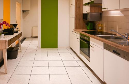 Kuchyň nebo kuchyňský kout v ubytování Exclusive Apartment Schönbrunn