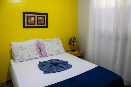 A bed or beds in a room at Pousada Do Suiá