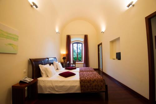 A bed or beds in a room at Alentejo Star Hotel - Sao Domingos / Mertola - Duna Parque Hotel Group