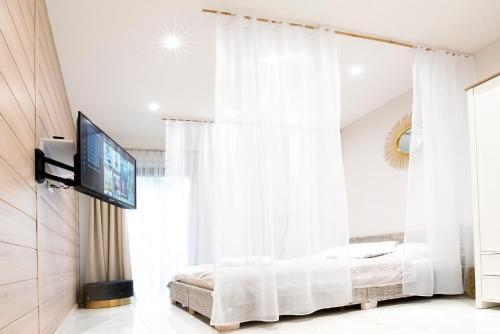 Łóżko lub łóżka w pokoju w obiekcie Bona Romantic SPA