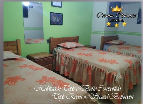 A bed or beds in a room at Hostal Corona Blanca