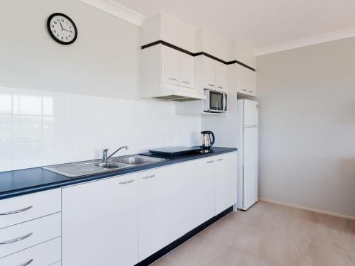 A kitchen or kitchenette at Villa 125 'Horizons' 5 Horizons Drive