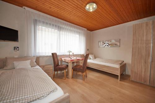 A bed or beds in a room at Pension Haus Gisela