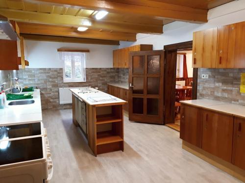 A kitchen or kitchenette at Horská chata U Pekařů