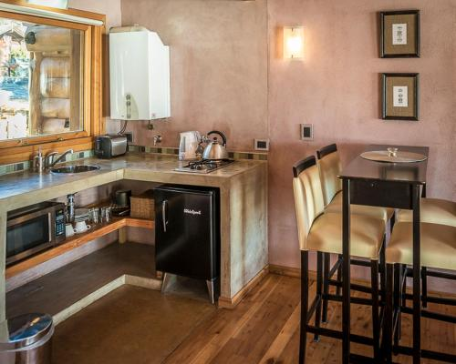 A kitchen or kitchenette at Lirolay Suites