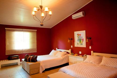 Cama ou camas em um quarto em Hotel & Golfe Clube dos 500