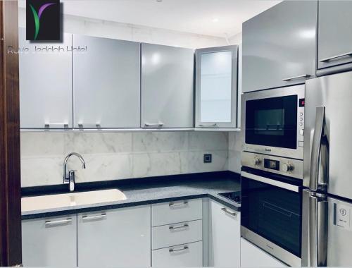 مطبخ أو مطبخ صغير في Ruve Jeddah Hotel