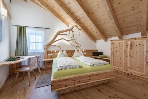 Ein Bett oder Betten in einem Zimmer der Unterkunft Platzbon