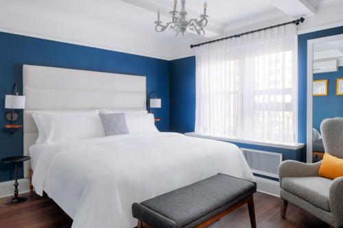 A bed or beds in a room at voco The Franklin New York