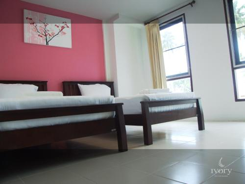 A bed or beds in a room at Ivory Phi Phi Island