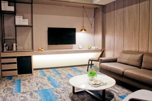 A television and/or entertainment center at Queena Plaza Hotel