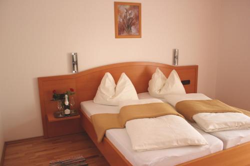 Letto o letti in una camera di Garni Hotel Villa Tamara