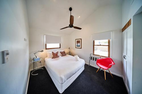 A bed or beds in a room at The Bronte Boutique Hotel